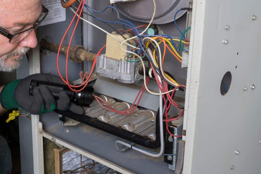 Why is my furnace making a loud banging noise when it comes on?