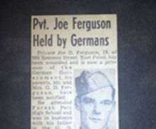 J.D. Ferguson was liberated from German captivity after being captured as a POW, spending time at Stalag II-B, and being discharged from the U.S. Army.